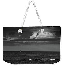 Weekender Tote Bag featuring the photograph Sailboat Into A Storm by Raymond Salani III