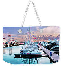 sailboats and yachts in the roads of the main sea channel of the Sochi seaport Weekender Tote Bag