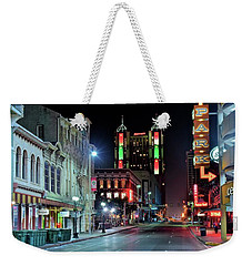 Weekender Tote Bag featuring the photograph San Antonio Alight by Frozen in Time Fine Art Photography