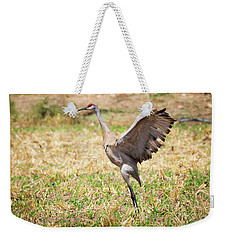 Weekender Tote Bag featuring the photograph Sandhill Crane Morning Stretch by Ricky L Jones