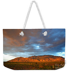 Sandia Mountains Colorful Sunset Weekender Tote Bag by Andrea Hazel Ihlefeld