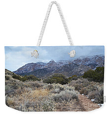 Sandia Mountains Storm Winter Landscape Weekender Tote Bag by Andrea Hazel Ihlefeld