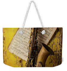 Saxophone Hanging On Old Wall Weekender Tote Bag by Garry Gay