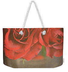 Weekender Tote Bag featuring the photograph Scarlet Roses by Lyn Randle
