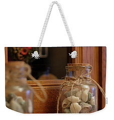 Weekender Tote Bag featuring the photograph Seashells by Jeremy Lavender Photography