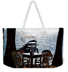 Weekender Tote Bag featuring the photograph Seaside Dining by Lawrence Burry