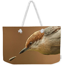Weekender Tote Bag featuring the photograph Seed Evades Nuthatch by Jim Moore