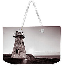 Weekender Tote Bag featuring the photograph Setting Sun At Cape Tryon Lighthouse by Chris Bordeleau