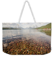 Weekender Tote Bag featuring the photograph Setting Sun On Lake Mcdonald by Margaret Pitcher