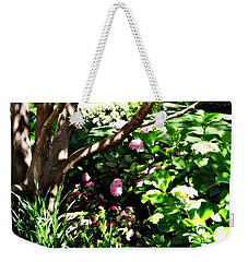 Weekender Tote Bag featuring the photograph Shadows Through The Garden by Glenn McCarthy Art and Photography