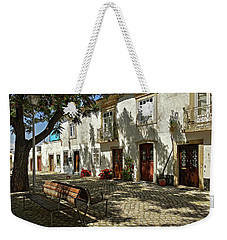Weekender Tote Bag featuring the photograph Shady Street In Tavira, Portugal by Barry O Carroll