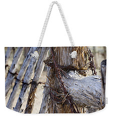 Weekender Tote Bag featuring the photograph Shaggy Fence Post by Phyllis Denton