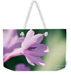 Weekender Tote Bag featuring the photograph She Listens Like Spring by Linda Lees
