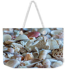 Weekender Tote Bag featuring the photograph Shell Ocean by Sabine Edrissi