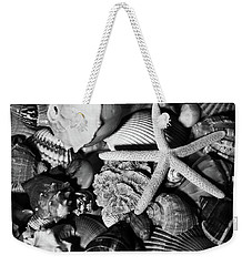 Weekender Tote Bag featuring the photograph Shells And Starfish In Black And White by Angie Tirado