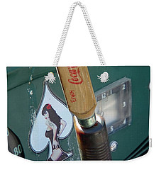 Weekender Tote Bag featuring the photograph Shifty Coke by Nick Kirby
