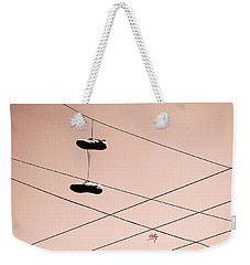 Weekender Tote Bag featuring the photograph Shoes On A Wire by Linda Hollis
