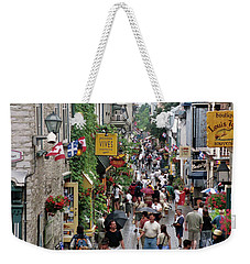 Weekender Tote Bag featuring the photograph Shop Till One Drops by John Schneider