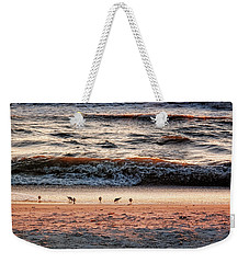 Weekender Tote Bag featuring the photograph Shorebirds by Lars Lentz