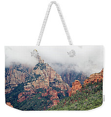 Weekender Tote Bag featuring the photograph Shrouded In Clouds by Phyllis Denton