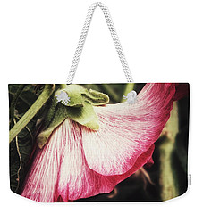 Weekender Tote Bag featuring the photograph Shy Hollyhock by Karen Stahlros