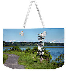 Weekender Tote Bag featuring the photograph Signs by Jeff Severson