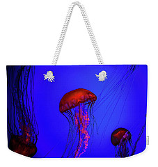 Weekender Tote Bag featuring the photograph Silent Jellies by Jeff Folger