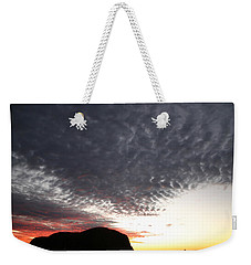 Weekender Tote Bag featuring the photograph Silhouette Of Uluru At Sunset by Keiran Lusk