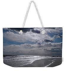 Weekender Tote Bag featuring the photograph Silver Linings Trim The Sea by Lynda Lehmann