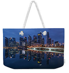 Weekender Tote Bag featuring the photograph Singapore Skyline Reflection by Pradeep Raja Prints