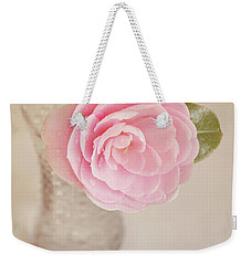 Weekender Tote Bag featuring the photograph Single Pink Camelia Flower In Clear Vase by Lyn Randle