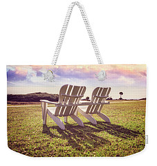 Weekender Tote Bag featuring the photograph Sitting In The Sun by Debra and Dave Vanderlaan