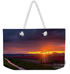 Weekender Tote Bag featuring the photograph Skagit Valley Tractor Sunstar by Mike Reid