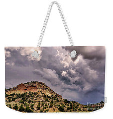 Weekender Tote Bag featuring the photograph Skies Over Montana by Gina Savage