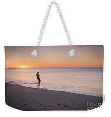 Weekender Tote Bag featuring the photograph Skipping Stones by Ray Warren