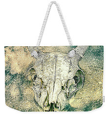 Weekender Tote Bag featuring the photograph Skully In The Clouds by Ronda Broatch