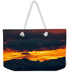 Weekender Tote Bag featuring the photograph Sky Lava by Colleen Coccia