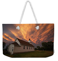 Weekender Tote Bag featuring the photograph Sky Of Fire by Aaron J Groen