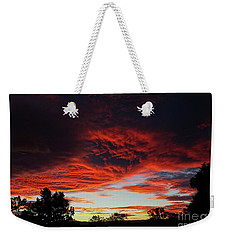 Weekender Tote Bag featuring the photograph Sky On Fire by Angela DeFrias