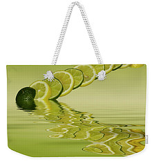 Weekender Tote Bag featuring the photograph Slices Lemon Lime Citrus Fruit by David French