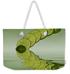 Weekender Tote Bag featuring the photograph Slices Lime Citrus Fruit by David French