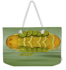Weekender Tote Bag featuring the photograph Slices Orange Lime Citrus Fruit by David French
