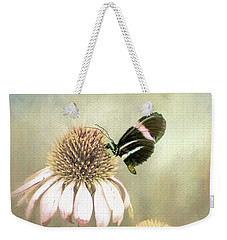 Weekender Tote Bag featuring the photograph Small Postman Butterfly On Cone Flower by Janette Boyd