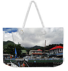 Weekender Tote Bag featuring the photograph Small Village by Gary Wonning
