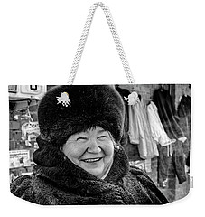 Weekender Tote Bag featuring the photograph Smiling Woman With Squinting Eyes by John Williams