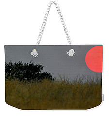 Weekender Tote Bag featuring the photograph Smokey Sunset by AJ Schibig