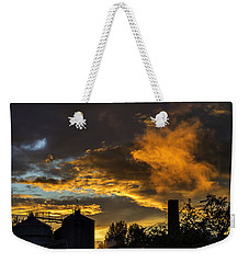 Weekender Tote Bag featuring the photograph Smoky Sunset by Jeremy Lavender Photography