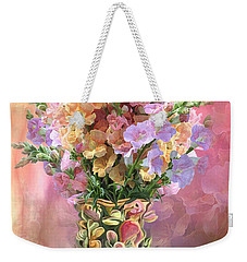 Weekender Tote Bag featuring the mixed media Snapdragons In Snapdragon Vase by Carol Cavalaris