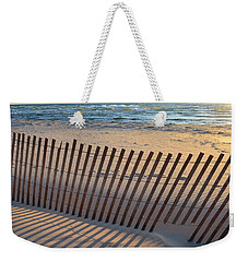 Weekender Tote Bag featuring the photograph Snow Fence On Lake Michigan by Michelle Calkins