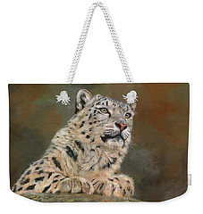 Snow Leopard On Rock Weekender Tote Bag by David Stribbling